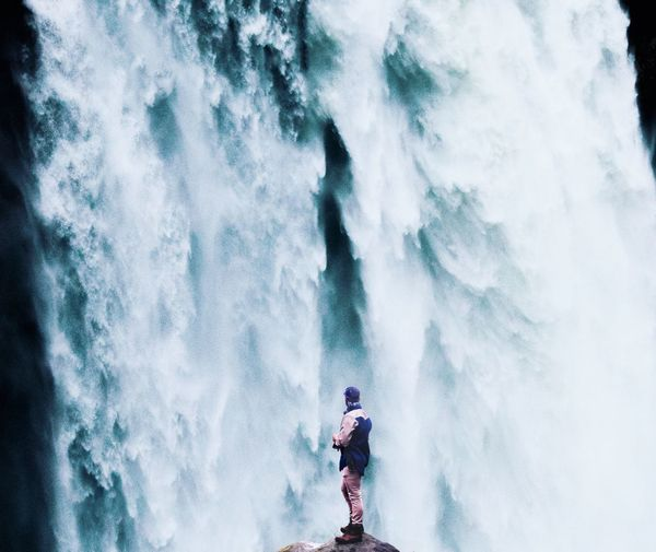 Hiking Adventure Waterfall Real People Nature Leisure Activity Beauty In Nature Lifestyles Day Outdoors One Person Full Length Men Motion Waterfall Adventure Scenics People Standing Sky Water