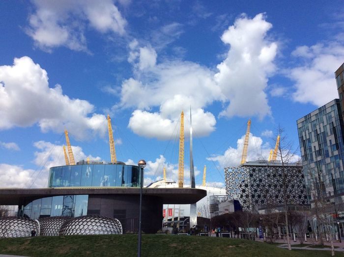 London North Greenwich O2 Arena Architecture Blue Building Building Exterior Built Structure City Cloud - Sky Construction Equipment Construction Industry Construction Site Crane - Construction Machinery Day Factory Incidental People Industry Low Angle View Machinery Nature Outdoors Sky