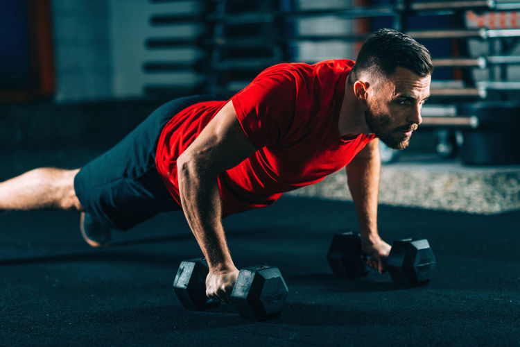 Male Athlete Doing Push-Ups In Gym