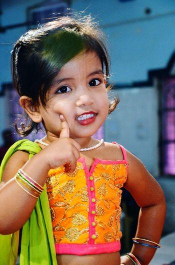 Portrait Of Cute Girl Wearing Lipstick