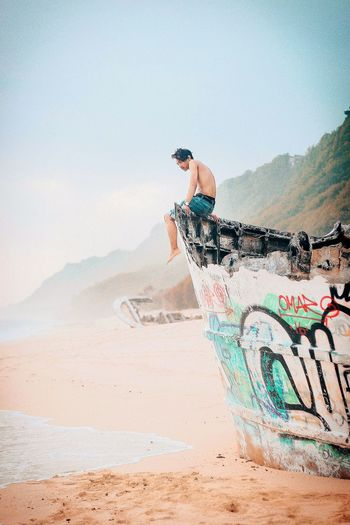 Just Hold On 🏝 Beach Broken Ship Sunset Portrait Sand One Person Sky Men Outdoors Adults Only Day People Adult One Man Only First Eyeem Photo EyeEmNewHere