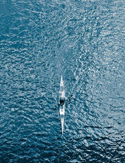 High angle view of man kayaking on sea