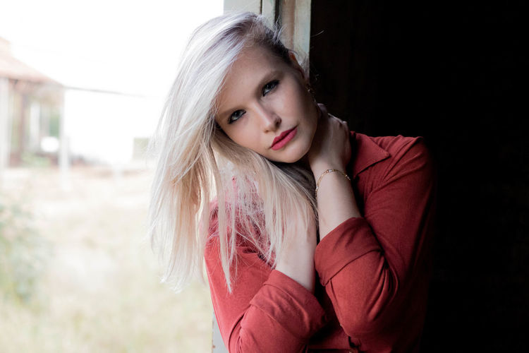 Portrait of young woman with blond hair