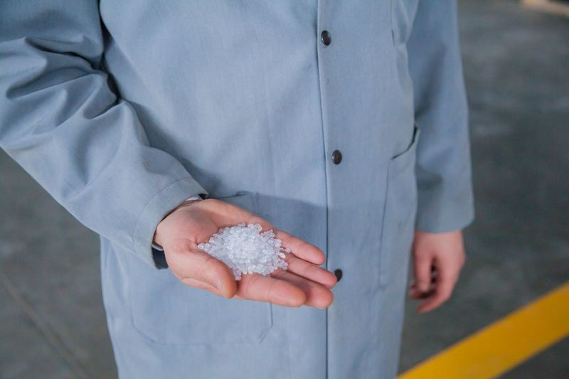 Close-Up Of Hand Holding White Polystyrene Balls