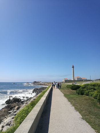 Leça da Palmeira Beach Blue Sea Clear Sky Horizon Over Water Outdoors Road Day Nature Vacations Water Grass Beauty In Nature Portugal City Porto Porto Portugal 🇵🇹 Building Exterior Travel Destinations Travel Built Structure Architecture Purist No Edit No Filter
