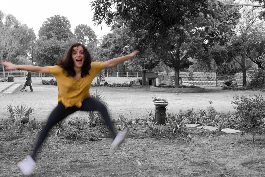 Black And White Blackandwhite Happiness Jumping Keycolor One Young Woman Only Outdoors Park Playground Paint The Town Yellow