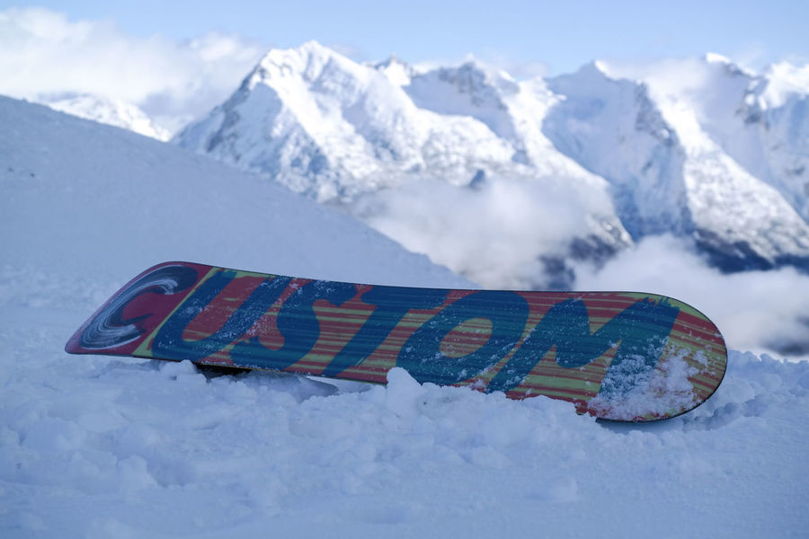 snowboard on top of a mountain Cold Temperature Day Mountain Nature No People Outdoors Snow Snowboard Winter