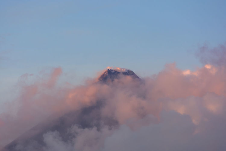 Low angle view of mountain against sky during sunset