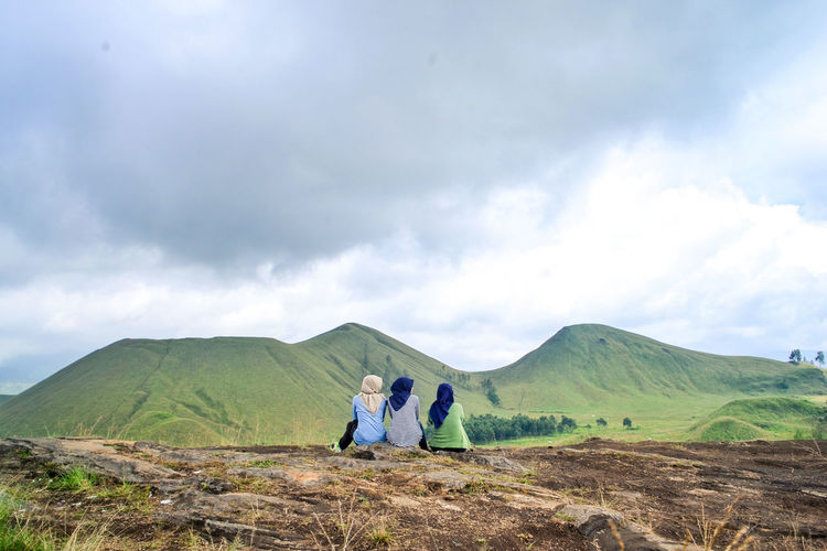 Cloud - Sky Sky Mountain Two People Nature Togetherness Scenics - Nature Men Beauty In Nature Day Landscape Real People Environment Land Tranquility Non-urban Scene People Leisure Activity Rear View Green Color Outdoors Positive Emotion Couple - Relationship