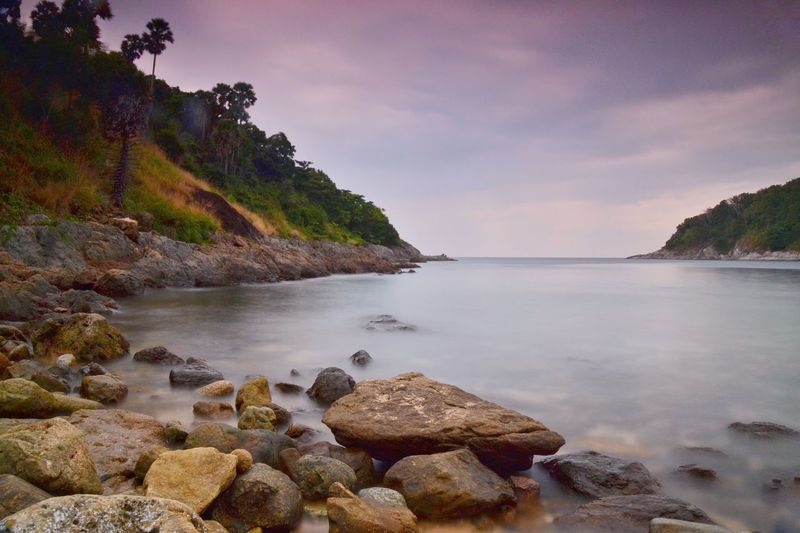 Curve Water Nature Sea Sky Beauty In Nature Tranquil Scene Scenics Tranquility Shore No People Outdoors Beach Day Rock Rock - Object Landscape Beauty In Nature One Person Long Exposure