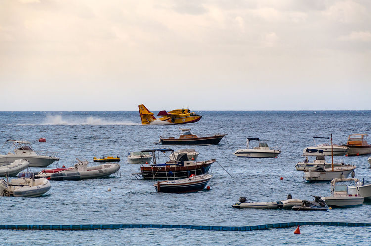 Canadair leaving for a firefighting mission on Amalfi's coast in Italy Amalfi Coast Brave Crime FireFighting  Mission Plane Action Aircraft Airplane Coast Dangerous Firefighters Flying Incendie Italy Maiori Sea Sky Speed