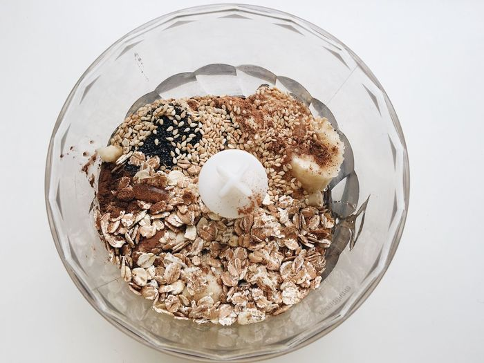 Oatmeal, sesame and poppy seeds, cacao, banana are in a bowl ready to be mixed and cooked into cookies Banana Blender Cacao Cook  Cooking Cooking At Home Culinary Delicious Desert Food Foodblog Foodie Healthy Ingredients Making Food Mix Mixer Oatmeal Poppy Seeds Recipe Sesame Seeds Sweets Tasty