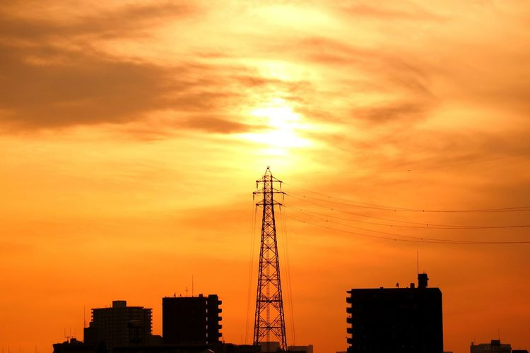 Steel Tower  Highvoltage Wire Sun Sunset Sunsets Orange Orange Sky Cityscape Evening Evening Sun Evening Glow Tower Sky Skyporn Cloud Cloudporn