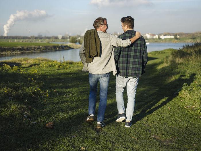 Friends standing on field