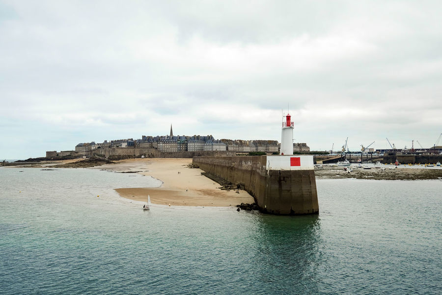 View of Saint-Malo from the sea. St. Malo Walled City Architecture Building Exterior Built Structure Cloud - Sky Day Lighthouse No People Outdoors Sea Sea And Sky Sky Water Waterfront