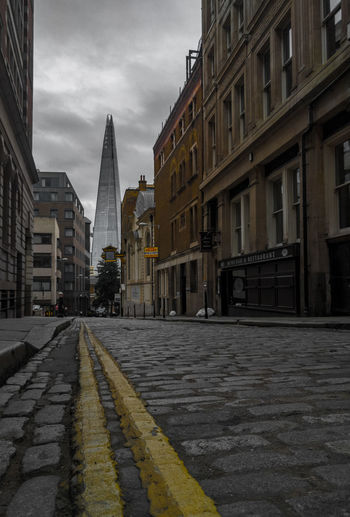 Film HDR London Low Angle View Road Architecture Building Exterior Built Structure City Colour Day Lofi No People Outdoors Road Road Marking Sky Street The Way Forward Vibrant Yellow