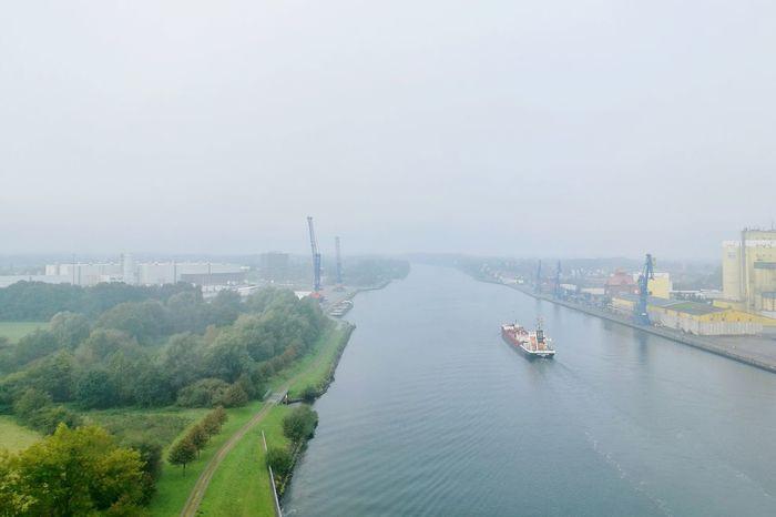 Water Nautical Vessel Transportation High Angle View River Bridge - Man Made Structure Boat City Mode Of Transport Waterfront Engineering Riverbank Day Canal Sky Outdoors Bridge City Life North Germany Vacations Kiel Canal Schleswig-Holstein Fog Nord Ostsee Kanal Channel