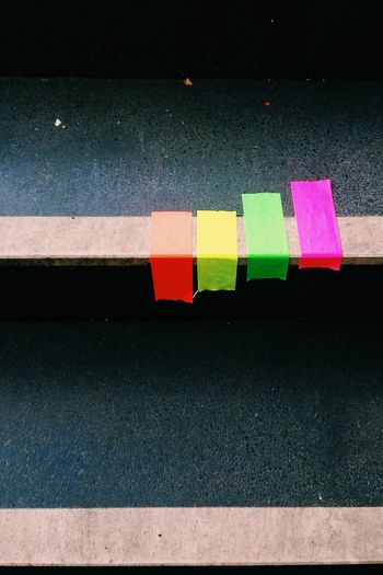 High angle view of colorful adhesive tapes on table