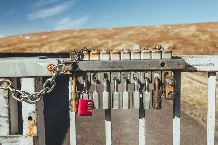 Close-up of padlocks outdoors