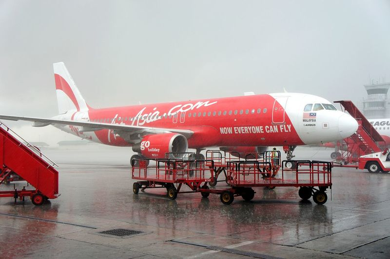 Air Asia plane in heavy rain at Kuala Lumpur Airport. Air Asia Airasia Air Asia X Rain Rainy Day Monsoon Heavy Rain Aviation Airbus A320 Airbus Kuala Lumpur International Airport Malaysia Airplane Airport Weather Bad Weather Thunderstorm Tropical Climate Cancelled Flight Delayed Flight DelayedFlight Newstrekker Gettylicious