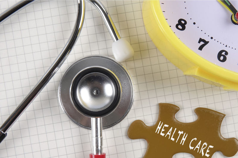 HEALTH CARE & MEDICAL CONCEPT WITH STETHOSCOPE AND PUZZLE. Close-up Communication Conceptual Photography  Directly Above Document Flooring Healthcare And Medicine Healthy Lifestyle High Angle View Indoors  Instrument Of Measurement Medical Supplies No People Paper Pen Shape Still Life Table Text Tile Western Script