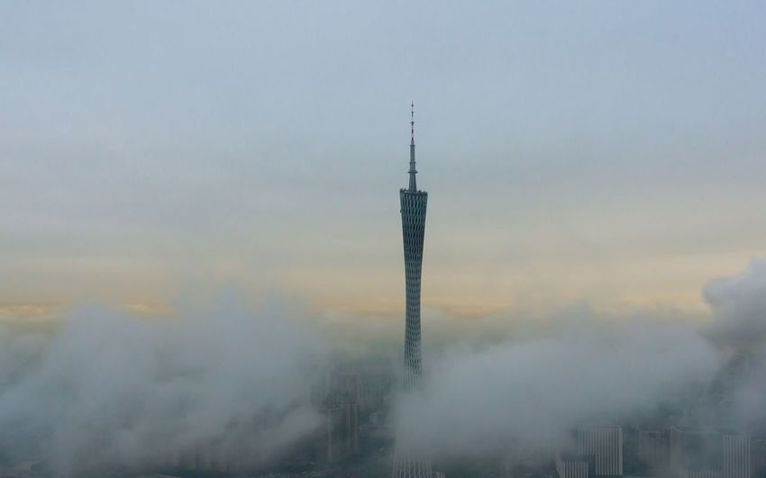 Communications tower against sky during foggy weather