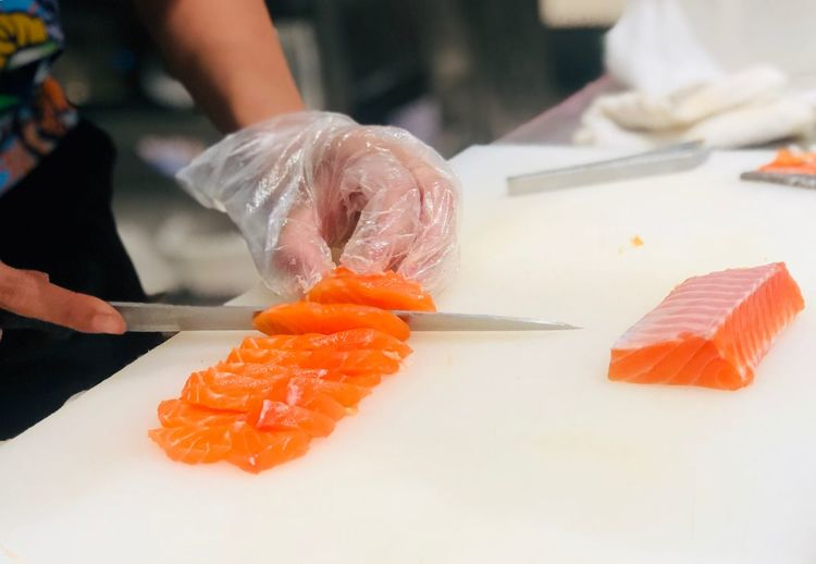 Cutting salmon fish EyeEm Selects Food And Drink Food Seafood Sushi Healthy Eating Japanese Food Human Hand Fish Freshness Wellbeing Salmon - Seafood Asian Food Indoors  Hand Raw Food Focus On Foreground Close-up Real People Human Body Part