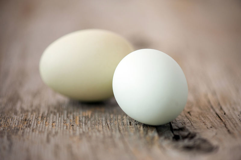 Close-Up Of Eggs On Wooden Table