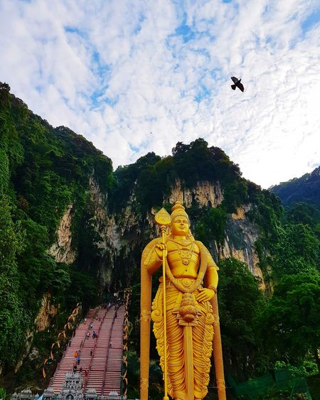 BatuCavesHinduTemple Batu Caves Beginner Level Statue Photography Beginnerphotographer Around_the_world Malaysia Hinduism Statue Statue In The City Hindu Temple Hindu God Lord Murugan Around Me Naturephotography Sky Gold Colored Morning Sky Cloud - Sky Photography