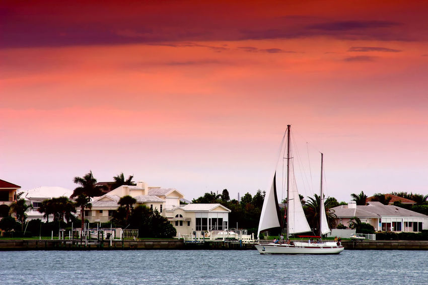 Boat Nautical Vessel Orange Color Pass A Grille Sail Boat Saint Petersburg Florida Scenics Sky Sunset Tampa Bay Tranquil Scene Travel Destinations Waterfront