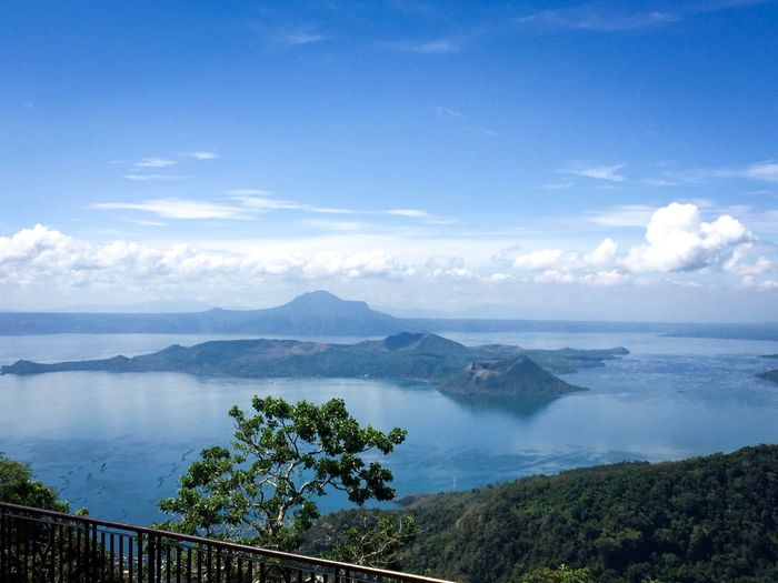Beauty Beauty In Nature Taal Volcano Lake View Lake Sky Water Scenics - Nature Beauty In Nature Cloud - Sky Tranquility Tranquil Scene Sea Tree Mountain Nature Plant Non-urban Scene Land Environment Day No People Travel Destinations Outdoors