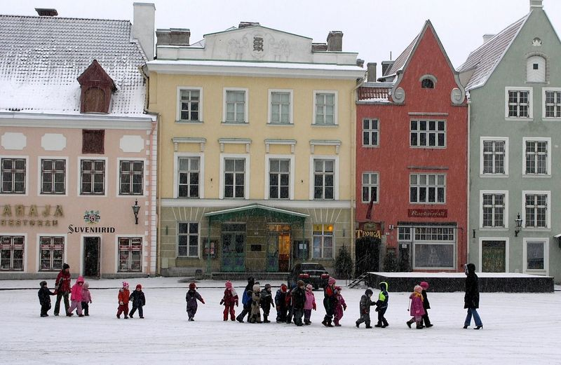 Group of people in building in city during winter