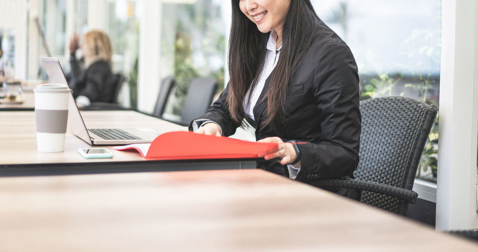 Midsection of businesswoman working in office