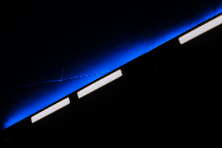 Low angle view of illuminated blue lights