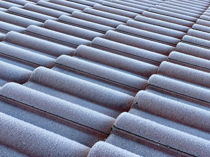 Rooftop View  Roof Tile Roof Cold Days Ice Cold Temperature Full Frame Backgrounds Pattern No People Day Textured  High Angle View Roof Tile Close-up Repetition Outdoors Architecture Roof In A Row Nature Sunlight Built Structure Design Winter Detail