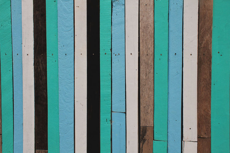 Colorful wood stripes. Backgrounds Blue No People Wood - Material Day Close-up Green Color Architecture Striped Built Structure Textured  Turquoise Colored Wall - Building Feature Outdoors Wood Background Beach Plank Water Wallpaper Pattern