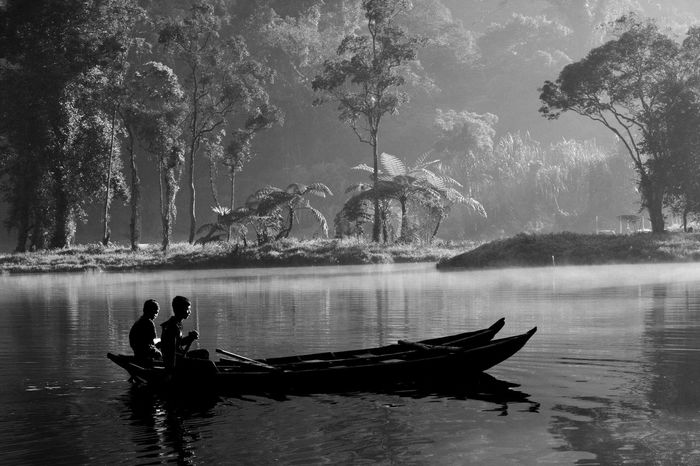 a beautiful morning in situ gunung, Sukabimi Indonesia. Adult Backgrounds Beautiful Beauty In Ordinary Things Day Daylight Fog Lake Mode Of Transport Nature Nautical Vessel One Person Outdoors People Postcard Poster Reflection Theme Tree Wallpaper Water Wonderful Prints Of Nature Print