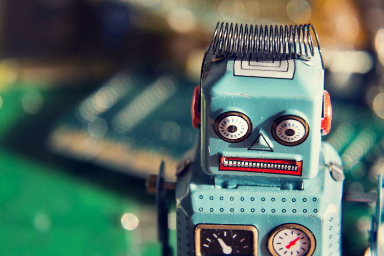 Vintage tin toy robot with green computer circuit board background, artificial intelligence, deep machine learning concept Big Data Green Science Artificial Intelligence Automation Circuit Board Computer Deep Learning Future Machine Learning No People Retro Styled Robot Technology Toy Vintage
