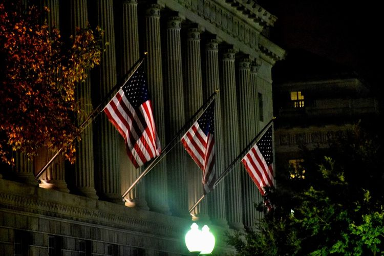 The flags are flying at the Treasury Building American Flag Architecture Built Structure Flag Low Angle View National Flag Outdoors Patriotism