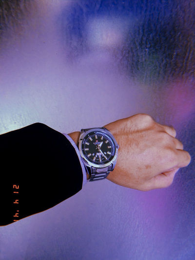 Clock Human Hand Hand Watch Human Body Part Time Wristwatch One Person Real People Men Indoors  Close-up Body Part Clock Lifestyles Leisure Activity Adult Males  Instrument Of Time Purple Personal Accessory Checking The Time