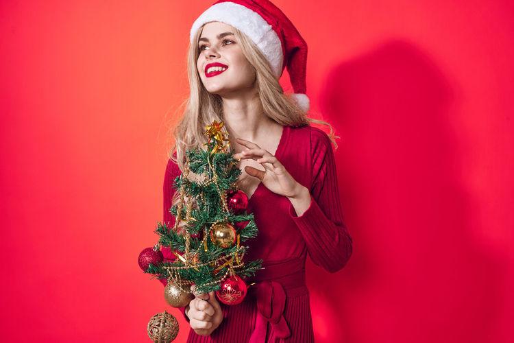 Full length of woman holding christmas tree