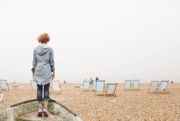 Beach Beauty In Nature Blonde Boat Brighton Casual Clothing Curly Hair Fog Foggy Full Length Girl Horizon Over Water Leisure Activity Lifestyles People And Places Rear View Scenics Shore Sky Standing Summer Tranquil Scene Tranquility Vacation Water The Secret Spaces Been There. Lost In The Landscape Connected By Travel Be. Ready. An Eye For Travel Visual Creativity