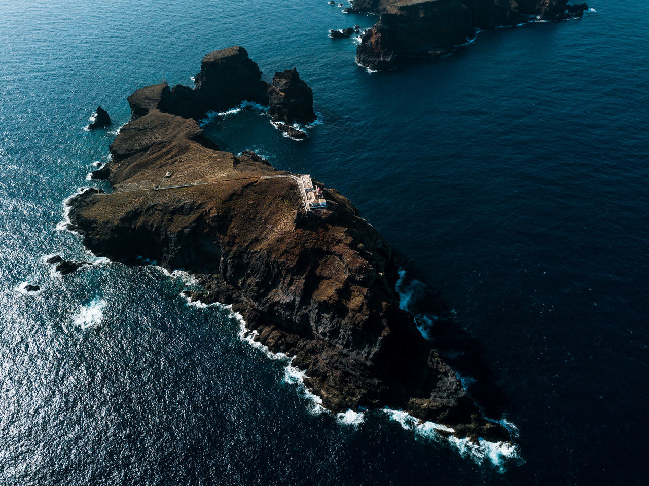 sea, rock formation, water, rock - object, high angle view, nature, cliff, beauty in nature, scenics, no people, rocky coastline, outdoors, day, physical geography