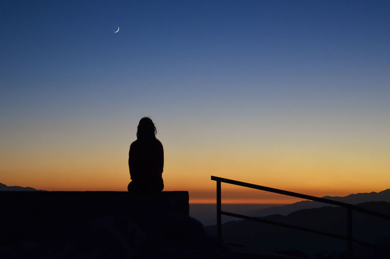 Waiting Wishing California Dreaming Dreams Waiting Wishes Astronomy Beauty In Nature Clear Sky Evening Girl Horizon Humble Magic Moon Mountain Nature Night One Person Orange Color Outdoors Real People Silhouette Sunset Vision