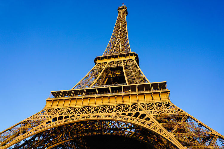Eiffel Tower Paris, France  Architectural Feature Architecture Blue Blue Sky Building Exterior Built Structure City Clear Sky Day History Low Angle View Metal Monument No People Outdoors Sky Tall - High Tourism Tower Travel Travel Destinations