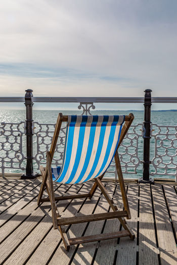 A Deckchair on Brighton Pier Brighton Deck Chair Deckchairs Pier Absence Beach Beauty In Nature Chair Cloud - Sky Horizon Horizon Over Water Land Nature No People Outdoor Chair Outdoors Relaxation Scenics - Nature Sea Seat Sky Tranquil Scene Tranquility Water Wood - Material