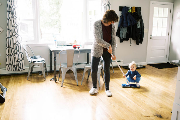 People on hardwood floor at home