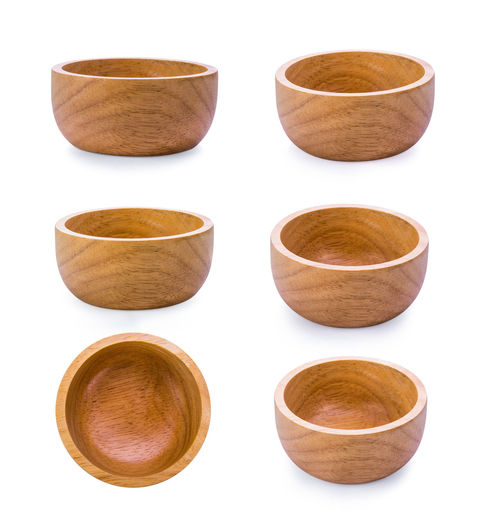 Montage of wooden bowls against white background