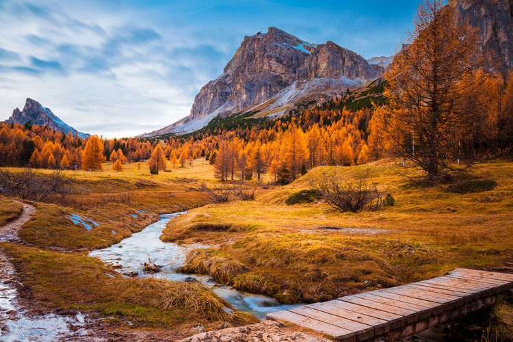 Autumn in Dolomites Dolomites Autumn Beauty In Nature Bridge Cloud - Sky Colorful Day Forest Idyllic Italy Landscape Long Exposure Mountain Mountain Range Nature No People Orange Color Plant Scenics - Nature Sky Stream Tranquil Scene Tranquility Tree Water