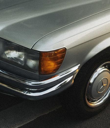 Reflection of illuminated car in mirror